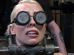Sexy blonde chick gets tied up and gagged. She also gets her shaved pussy drilled deep by her inventive master.