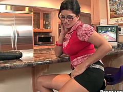 Sunny Leone just got back home. She's in the kitchen with nothing to do but get naked and masturbate.