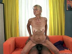 Although she is an old woman she still knows how to give a good blowjob. She sucks her lover's meaty cock with great enthusiasm paying special attention to his balls. Since that prick is already hard she climbs on top of her lover and fucks him hard in this position.