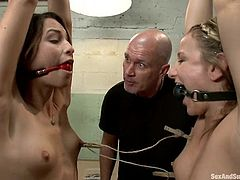 Amber Rayne and her pretty GF are having fun with Mark Davis indoors. Mark binds the girls, pulls them by the nipples and then fucks their amazing holes.