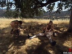 Two men get tied up and whipped somewhere in a forest. Then chicks give a handjob to guys. Later on these dudes get their asses drilled with strap-ons.