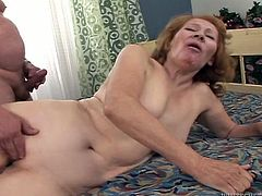 Whore wife gets her stretched insensible pussy drilled hard by one young dude. She moans under the waves of pleasure while he penetrates her snatch in missionary style.