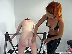 Pigtailed slut Ivy is playing dirty games with redhead mistress Kendra James. Kendra beats Ivy and then fucks her twat with a strapon doggy style.