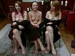 Group of sexy chicks in the uniform get choked and humiliated by their unmerciful mistress. Later on theses girls get toyed rough with different devices.