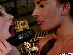 Wicked dominatrix grabs her sex slave by her head and pulls her towards her fake phallus so she can blow it. She sucks that black dildo greedily as if there's no tomorrow.