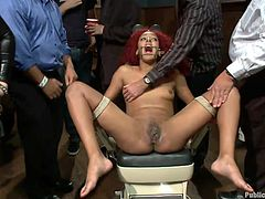 Frizzy hair redhead is the special quest to this party. The men are having a great time with her, drinking from their cups and playing with her immobilized body. The Creole slut stays there tied up and with her legs spread as the guys grope her tits and rub her tormented pussy with a vibrator.