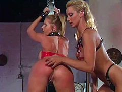 Two stunning girls in latex and high heels make hot femdom show. They spank asses and then one of the girls get toyed with a strap-on by her mistress.