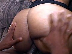 This chocolate sweetie has a huge ass. She shows her ass off when she rides this guy's massive rod and when she lays on her side and he slams her juicy pussy.
