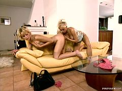 Two awesome blondes Stacy Silver and Tina Wagner are having a good time in the living room. They please each other with cunnilingus and then practise scissoring on the sofa.