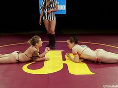 Cheyenne and Bella lay down on their stomachs and the referee give them the signal, to start the arm wrestle. The arm wrestling turns into a real wrestling match and after, rolling around and eating cunt, they have a third contestant enter the ring.