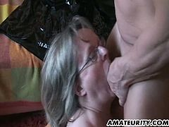 Check out this chubby mature with glasses sucking cock like a champ then spreading her legs for his massive schlong to nail her cunt!