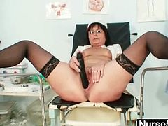 Kinky woman in medical gown and stockings lies on a gynecological chair with her legs wide opened. She fingers and then toys her vagina with different sex toys.