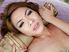 Lusty red head slut gives outstanding blowjob. The size of the rod she is sucking in the video is really impressive. Watch this tiny Asian chick taking the tool in her pussy missionary style.