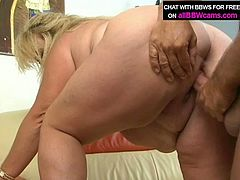 Slutty mommy with huge natural boobs and fat belly gets her pussy fingered so it goes wet and slick. After she gets on top of hard shaft riding actively in reverse cowgirl position. Later in the clip, she gets nailed missionary style,