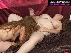 Filthy lesbian porn scene feating thick slut with huge boobs and skinny girl having miserable tits. Skinny one puts on a strapon and stuffs her lover's cunt with the tool. They fuck doggy style.