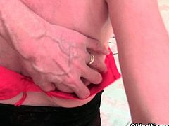 Watch a vicious and skinny mature taking her clothes off and playing with her hairy cunt before a dude comes to help her.