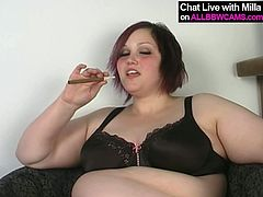 Slutty Caucasian girl with round body shape takes off her clothes exposing her goodies. Then she slides her fingers between fat pussy lips entering wet slit.