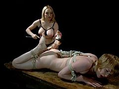 Sexy blonde mistress in latex uniform ties Alani up. Then she spanks and whips her sex slave and gets her pussy licked. Alani also gets her vagina drilled with dildo.
