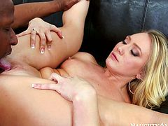 Ardent blondie bends over a couch to welcome a portion of hard fuck from behind before she lies on her back and spreads her legs wide to get her pussy eaten by voracious beefy black dude in interracial sex vid by Naughty America.