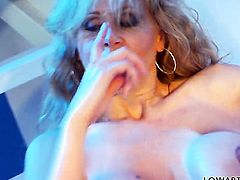 Julia Ann stripping down to her bare skin