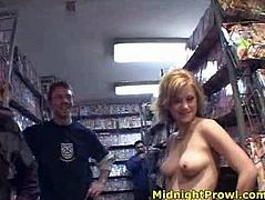 Frisky blond chic heads to the CD store where a bunch of kinky dudes ask her to get undressed for 50 bucks and she is ready to do it. She takes off her clothes flashing her baggy tits in gangbang sex video by Pornstar.