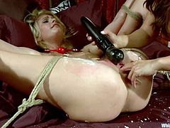 Sexy mistress if fucking her petite sex slave with a huge toy
