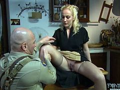 Blonde housewife Monica Preziosi gets her pussy eaten by a horny soldier. She opens her legs and he licks and eats that wet pussy