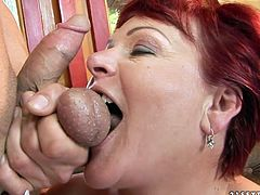 Immense red-haired mature BBW takes a slim hard cock into her mouth for a blowjob before she climbs on it for a ride in reverse cowgirl style in sizzling hot sex video by 21 Sextury.