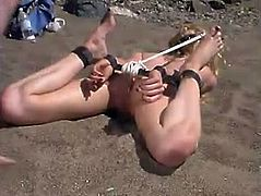 They were supposed to chillax on the beach, but the relaxation turns into a severe bondage session. Well, the blondie loves it and she won't ask her man to stop giving her pain.