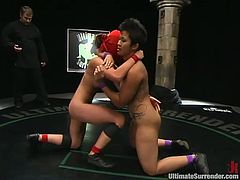 Crimson Ninja and DragonLily are having a battle on tatami. The girls wrestle with each other and then the showrt-haired brunette Crimson fucks Lily's tight Asian cunt.