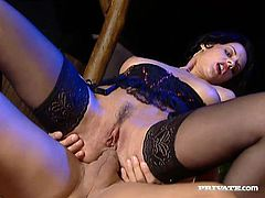 Sexy brunette Michelle Wild wearing a corset and stockings is having a good time with a handsome man. She favours him with a blowjob and then allows the dude to fuck her vag and ass in all positions.