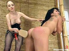 Blonde bombshell Chanta-Rose is having fun with Roxy Jezel indoors. Rose spanks Roxy with a ping-pong racket and then pounds her twat with a strapon.
