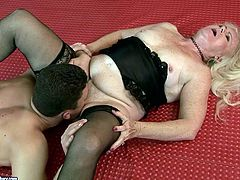 This old woman in sexy black stockings has a huge sexual appetite. Shameless granny spreads her legs wide and lets her lover get a taste of her hairy snatch. Then she gets her muff fucked in missionary position.