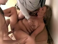 Mature blonde Roxy Blaze sucking two guys cock in a military office and does missionary and doggystyle until she gets cum in mouth.