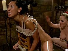 Lecherous blonde Aiden Starr is playing dirty games with Tia Ling in a cellar. She ties Tia up and fucks her Asian vag with a strapon as hard as she can.
