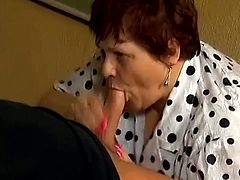 Fat hoe with big ass and big boobs is sucking that hard cock and makes it ready for her vagina, she gets that thing on the office table.