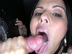 Press play on this hot clip and watch Diamond Kitty ends up with her mouth filled by cum after she sucks on a big cock poking out of a gloryhole.