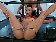 Long legs Nikki is having a shocking, lesbian experience with her blonde girl Lea. She has been positioned with those sexy legs spread wide, her pussy was gaped with medical clamps and now Lea plays with her. She shocks her nipples with electric wands and rubs gently that juicy, tight cunt.