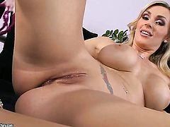 Blonde Tanya Tate with giant boobs stripping for you to enjoy in solo action