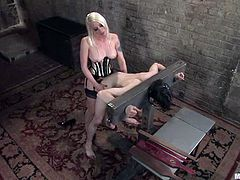 Nasty blonde mistress tortures guy's dick and fixes clothespins to his nipples. Later on she whips and drills his ass with a strap-on.