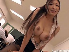 Japanese teacher with big tits and horny pussy showing her big tits in class and panties, then gets a toy vibrator in pussy.