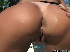 Watch this Brazilian slut swallowing a big load of milk in this hardcore after she's fucked by a big cock on a beach chair.