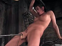 Hot brunette in black lingerie and high boots gets bounded with a special bondage devices. After that she gets her pussy toyed deep and hard by the fucking machine.