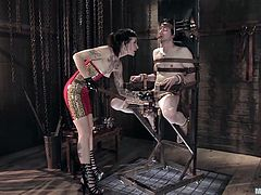 She's hot, mean and doesn't shows mercy to men. Simone tied her man Kade on a chair and now, that he's immobilized with leather belts, the whore tortures him. She induces him pain with that tool and tortures his dick, just the way she likes it. All that pain and teasing makes Simone horny, so will she suck it too?