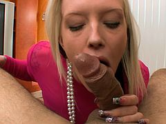 After a deep and amazing blowjob, blonde hottie gets covered in jizz