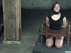 Sexy girls get tied up and gagged. Later on the guy fixes metal pins to their tits. Then he also puts them in the stocks.