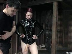 This amazing blond siren is getting penetrated by a filthy redhead in latex. She ties her up and starts drilling her twat with a strapon dildo!