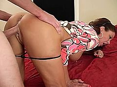 A kinky dark-haired mom is playing dirty games with some stud. She gives him a handjob and then gets her shaved cunt drilled in missionary and other positions.