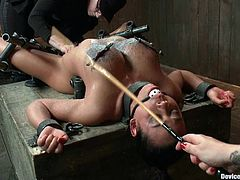 Bonded brunette girl with big boobs gets her tits and pussy tortured. Later on she gets her big boobs covered with hot wax.