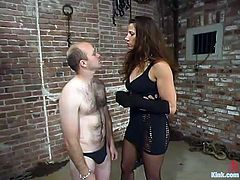 This kinky brunette mistress undresses a guy and also chokes him. Later on she spanks his ass and pinches nipples with claws.